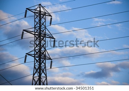 electrical pylon against blue sky / industrial background / concept for infrastructure