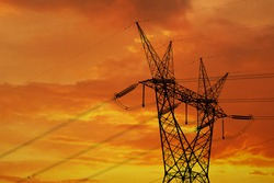 Electrical pylon and high power lines against a dramatic sunset