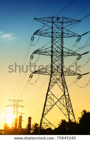electrical pylons at blue and orange sunset