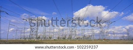 Electrical pylons in front of transformers