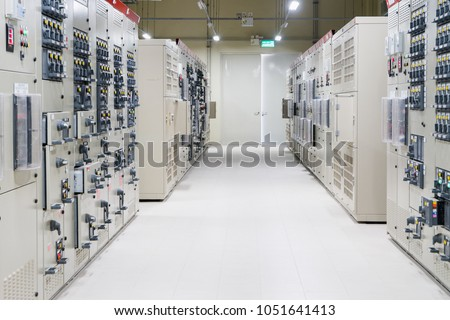 Electrical Room, medium and high voltage switcher, equipment, panel to control and protect the electrical equipment and system by fuse, circuit breaker, control panel at power plant and substation.