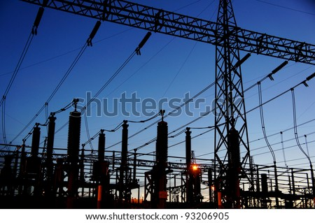 electrical substation silhouette on blue sky