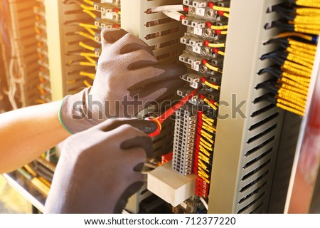 Electrical terminal in junction box and service by technician. Electrical device install in control panel for support program and control function by PLC. routine visit check equipment by technician. #712377220