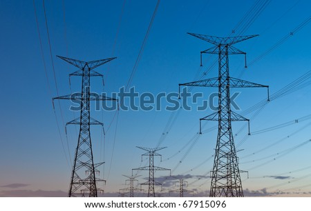 Electrical transmission towers carrying high voltage lines.