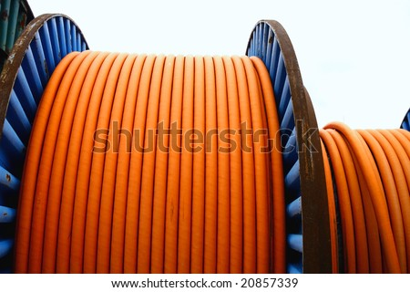 electrical wires on wooden spool - stock photo