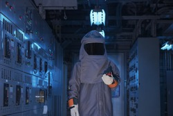 Electrical worker wearing arc flash suit  protection