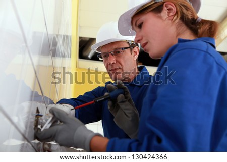 Electrician and his apprentice