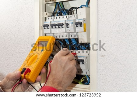 Electrician doing some checks on a light box
