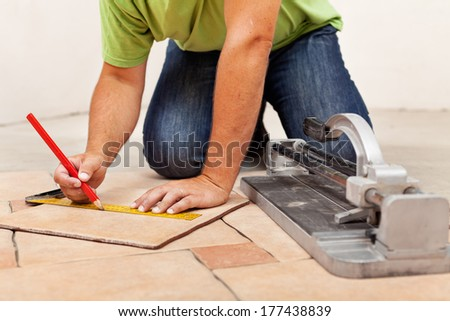 Electrician hands installing electrical wall sockets - closeup, focus on the fixture