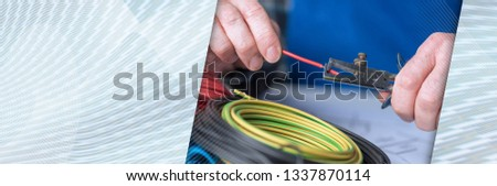 Electrician hands stripping a wire. panoramic banner #1337870114