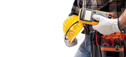 Electrician holds multimeter tester in hand, helmet with protective goggles. Construction industry, electrical system. Isolated on a white background.