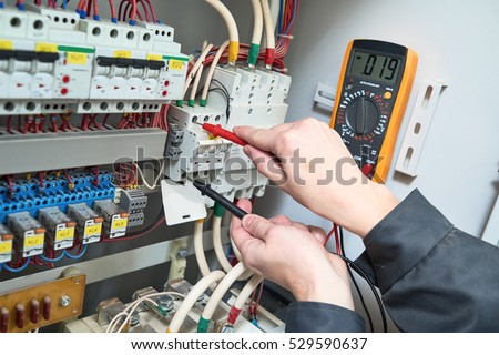 electrician measurements with multimeter tester #529590637