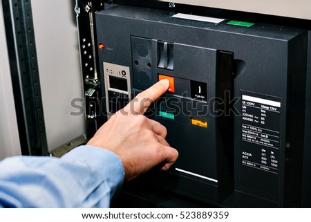 Electrician near the low-voltage cabinet. Uninterrupted power supply. Electricity. #523889359