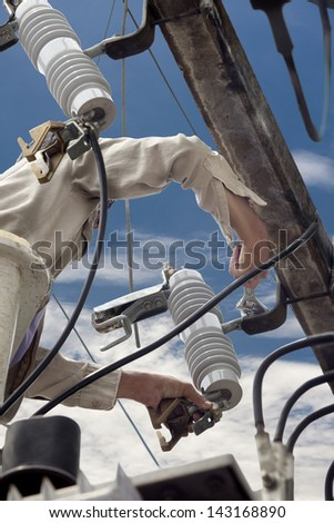 electrician repair the parts of high voltage transformer