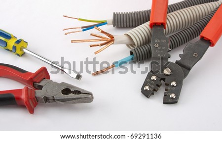 Electrician's tools. Pliers, cables, cutter and screwdriver