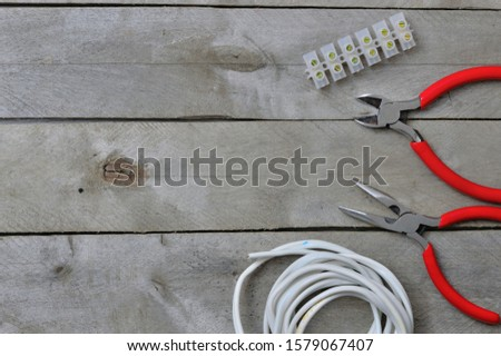 electrician tools on wooden background #1579067407