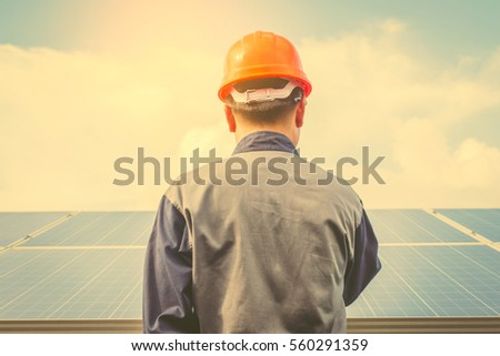 electrician working on checking equipment of operation plan in solar power plant   #560291359