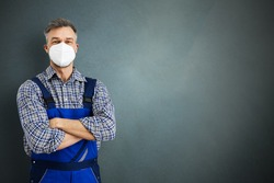Electrician Workman Or Plumbing Repairman In Face Mask