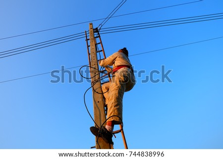 Electricians are climbing electricity poles. To install the electrical system #744838996