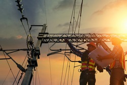 Electricians are climbing on electric poles to install and repair power lines.electricians work with high voltage electricity.