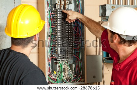 Electricians identify a 20 amp breaker that has gone bad and replace it.
