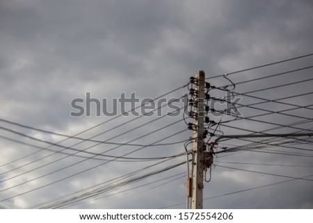 Electricity and internet cables and electricity poles