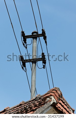 Electricity and telephone cable carrier on a house roof mounted
