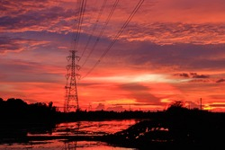 Electricity distribution station. high voltage electric transmission tower. high-voltage power lines at sunset. Silhouette image. High voltage tower and Colorful sky. transmission towers