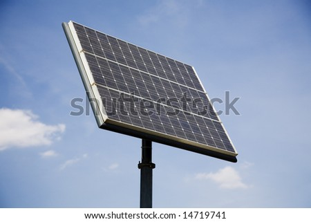 Electricity-generating solar panel against sunny blue summer sky