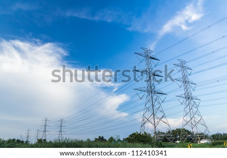 electricity high voltage power post against blue sky #112410341