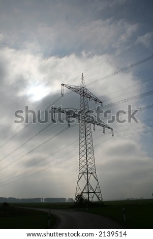 electricity pole on a dark cloudy background