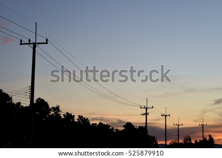 Electricity poles at the roadside with beautiful blue sky before sunset,Photos back - light at the horizon began to turn orange #525879910