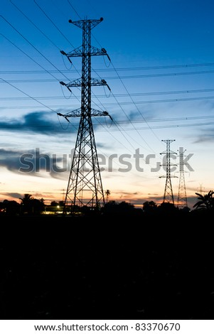 Electricity poles in twilight time in rural place