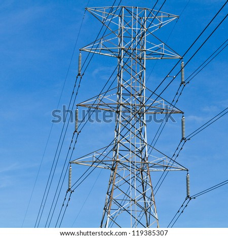 Electricity post in the blue sky.