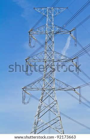 electricity post with blue sky