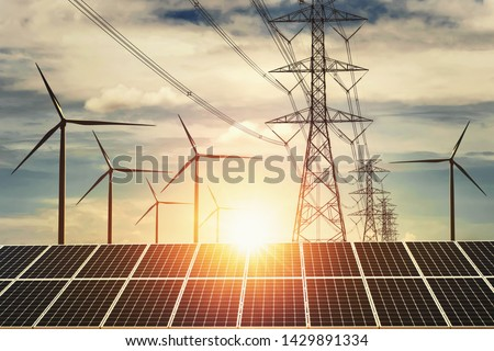 electricity power in nature. clean energy concept. solar panel with turbine and tower hight voltage sunset background #1429891334