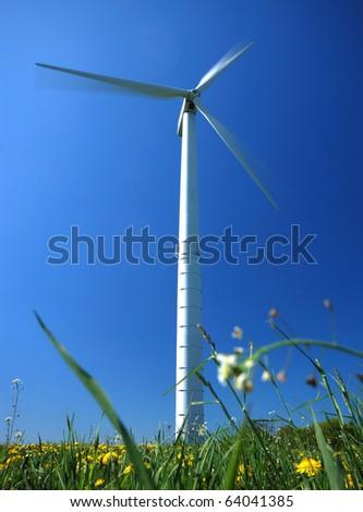 Electricity power wind turbine against blue sky background