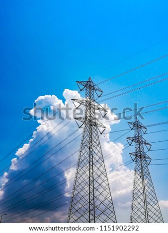 Electricity pylon low angle view against blue sky and cloud #1151902292