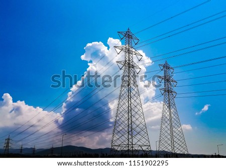 Electricity pylon low angle view against blue sky and cloud #1151902295