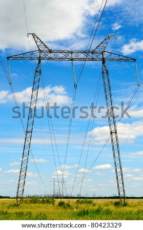 Electricity pylon of high voltage line in green field