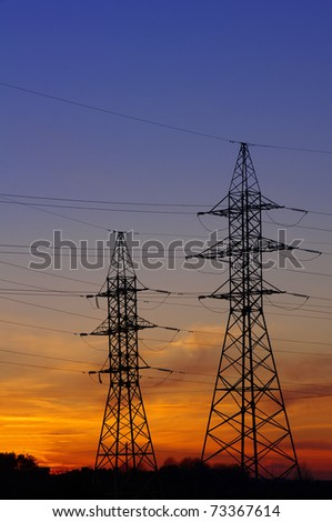 Electricity Pylon over orange sunset sky
