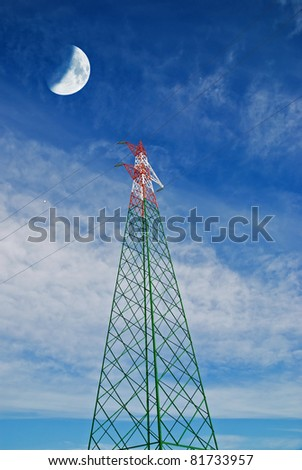 electricity pylon under cool cloudy sky with moon