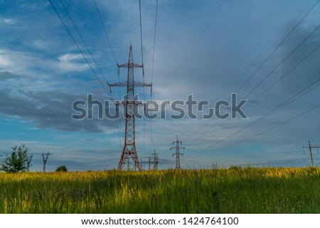 Electricity pylons and beautiful clouds #1424764100