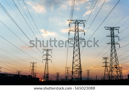 Electricity pylons and power lines, at sunset