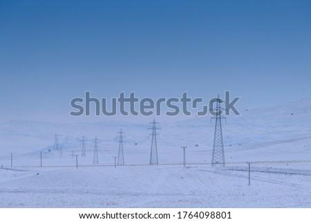 Electricity pylons and power lines, winter electrical malfunctions. high voltage post. High-voltage towers Stok fotoğraf ©