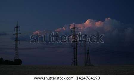Electricity pylons andmovement of clouds. Sunset #1424764190