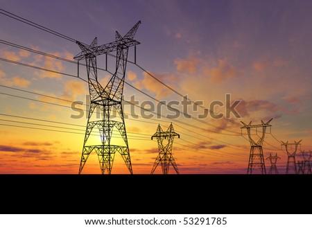 Electricity pylons at orange sunset