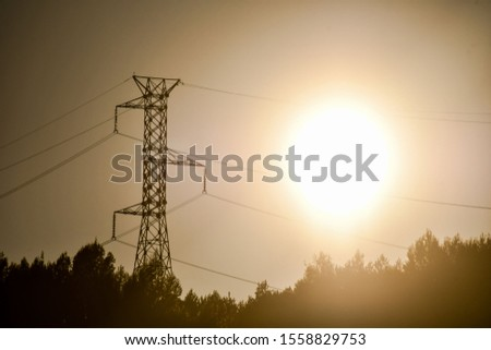 electricity pylons at sunset, photo as a background #1558829753