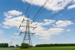 Electricity pylons in a field with blue sky. Much Hadham. Hertfordshire. UK