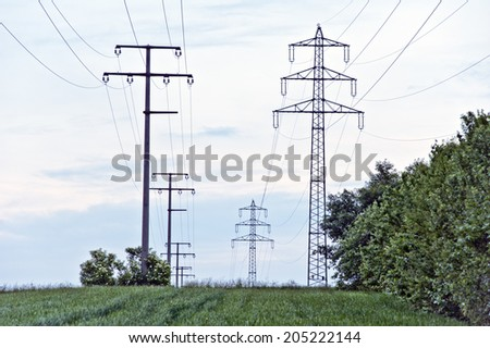 electricity pylons in the green field